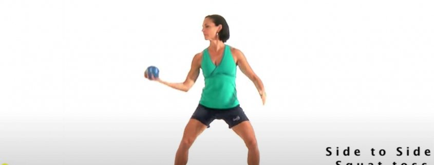Fitness expert Michele Vaughan demonstrates a proprioception exercise with a med ball toss